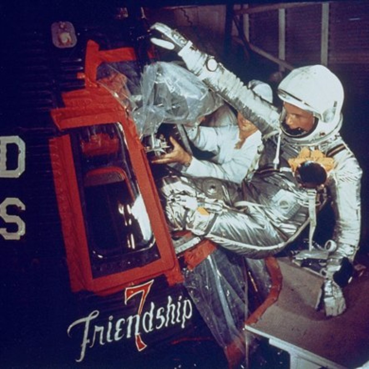 Friendship 7 artwork can be seen as John Glenn enters the capsule. Photo courtesy of NASA.