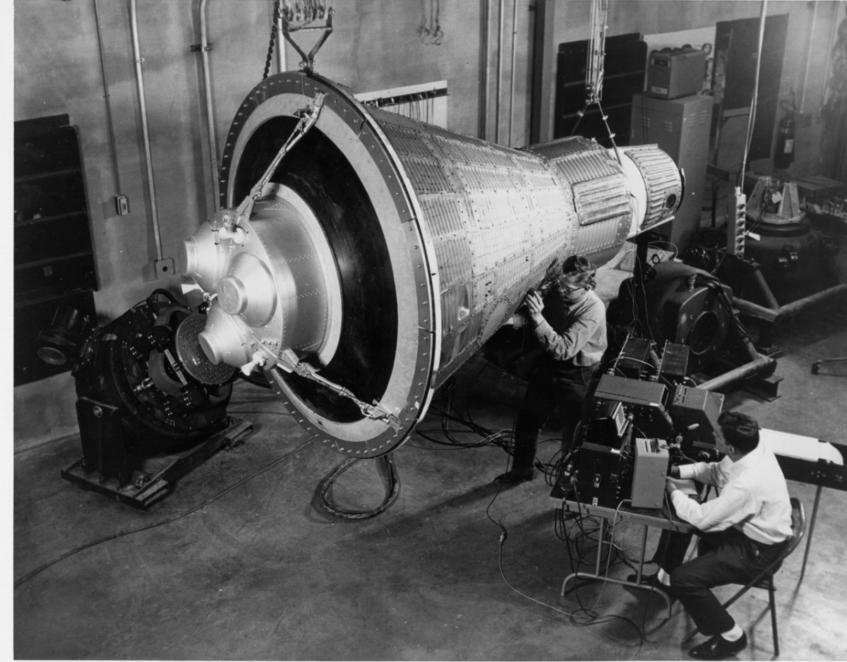 Engineers examine a Mercury capsule. Image courtesy of NASA.