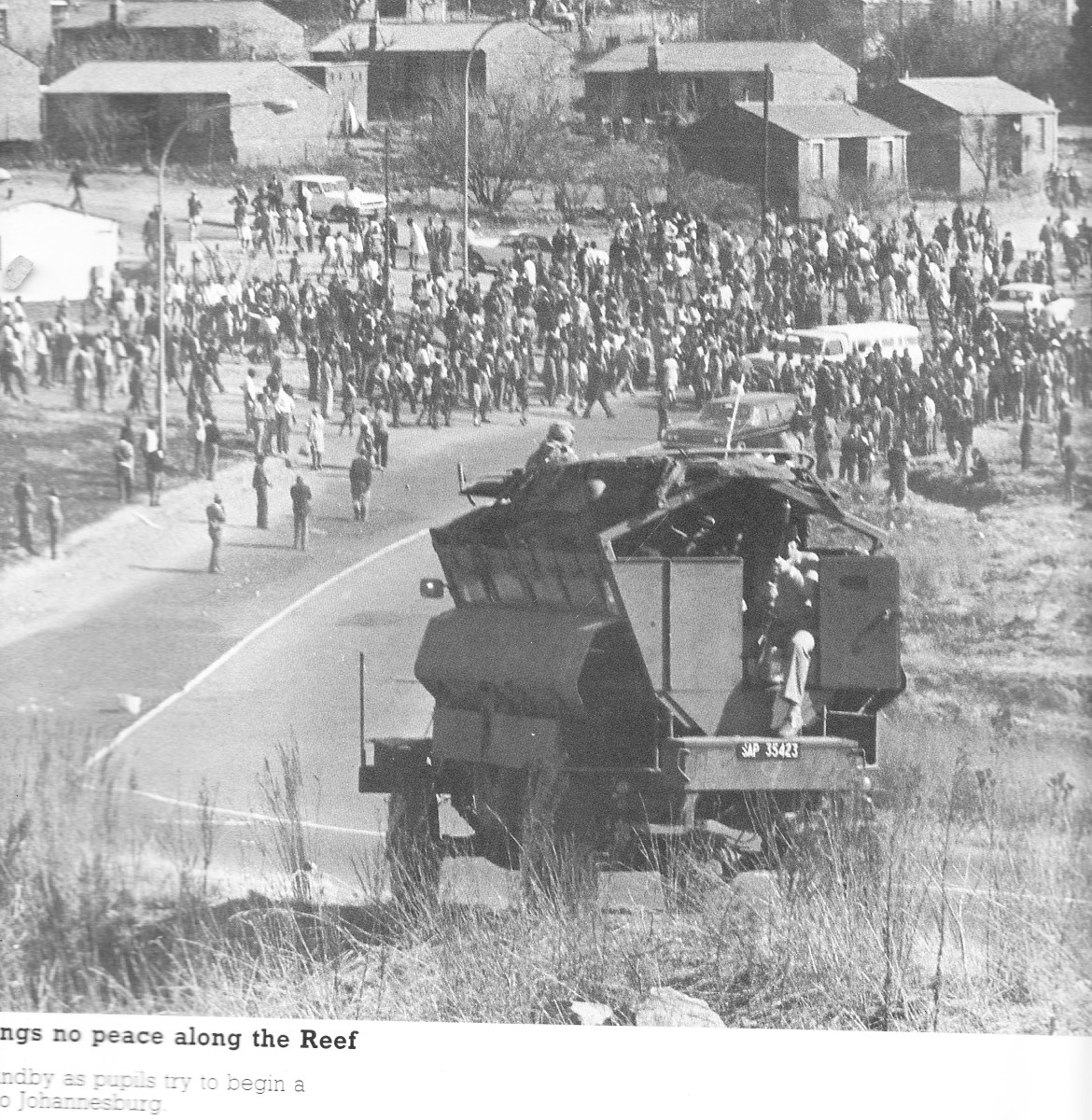 "On June 17th, students decided to march to Johannesburg Downtown, as seen on the picture moving towards Canada Railway station, and stopped by police and soldiers in their ""Hippos"""