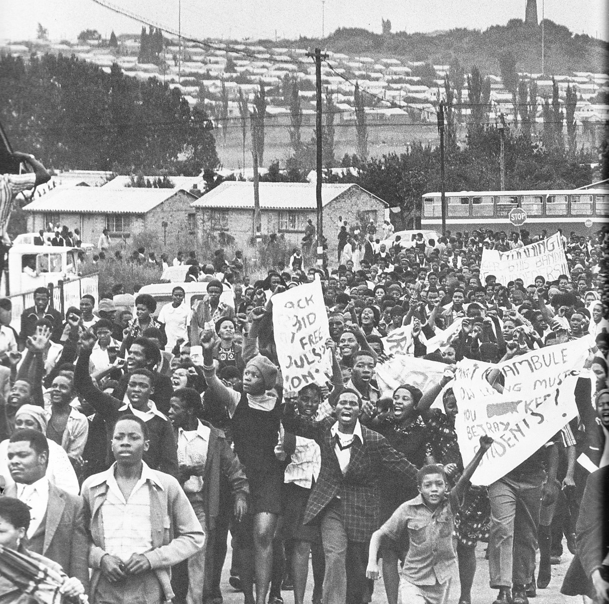 A large column of students marching in an orderly manner and in high spirits carrying their placards, which were simple and to the point messages