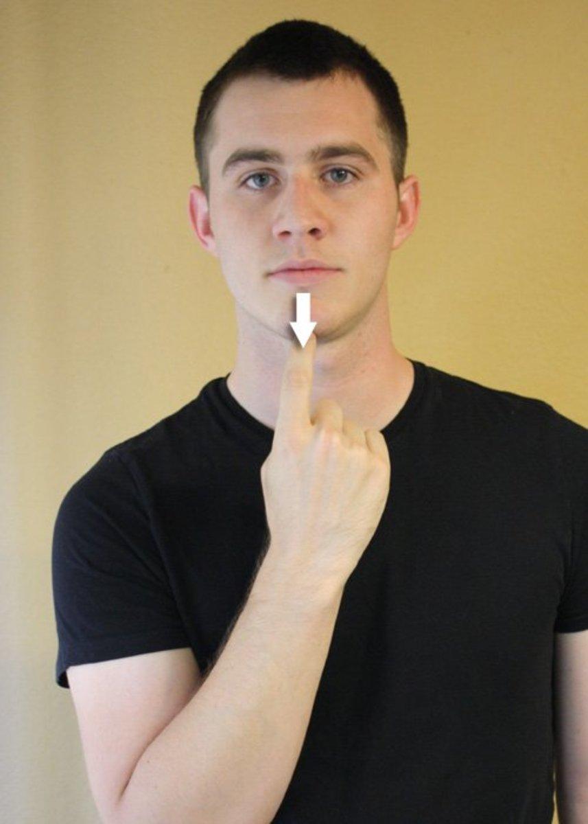 Index finger slides down the chin.