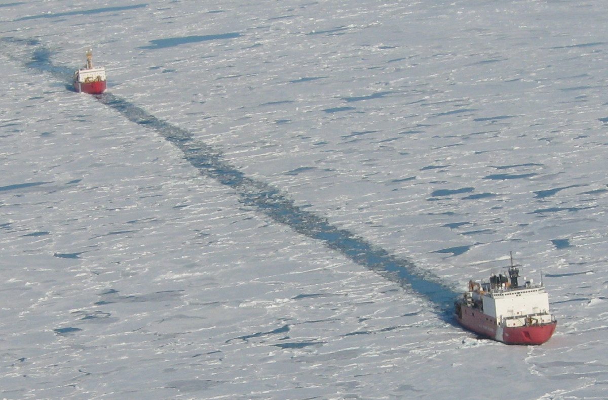 USCGS Healy and CCGS St. Laurent cooperate in a sonar survey of the Arctic Ocean seafloor, despite the clashing territorial claims the two nations stake in the High Arctic.  Image courtesy NRC.