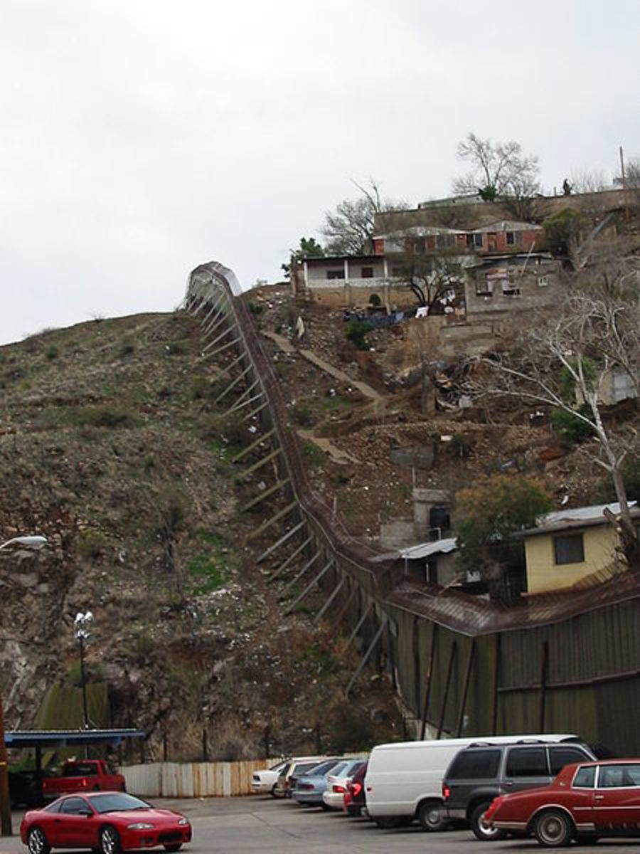 US-Mexican border, Nogales, Arizona.  Mexico is to the right.  Image courtesy Wikimedia Commons.