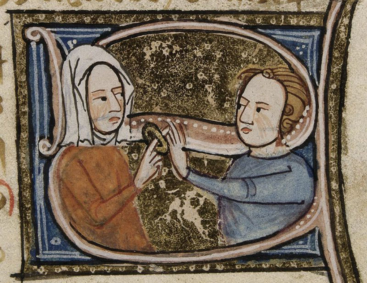 Man placing a ring on the finger of a medieval bride.
