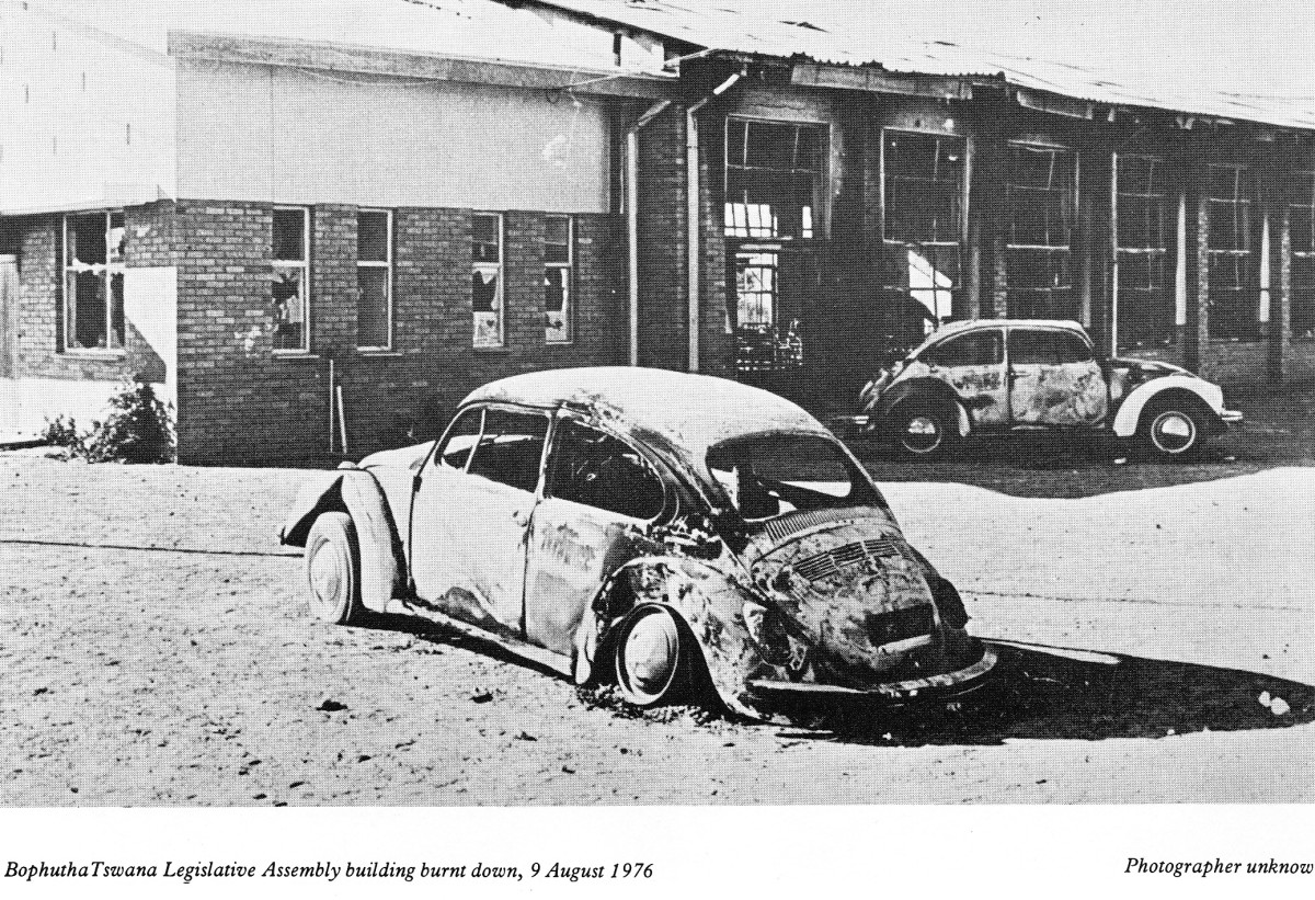 Burned out Volkswagen belonging to the some government administrative official in Bophutatswana Legislature, August 1976
