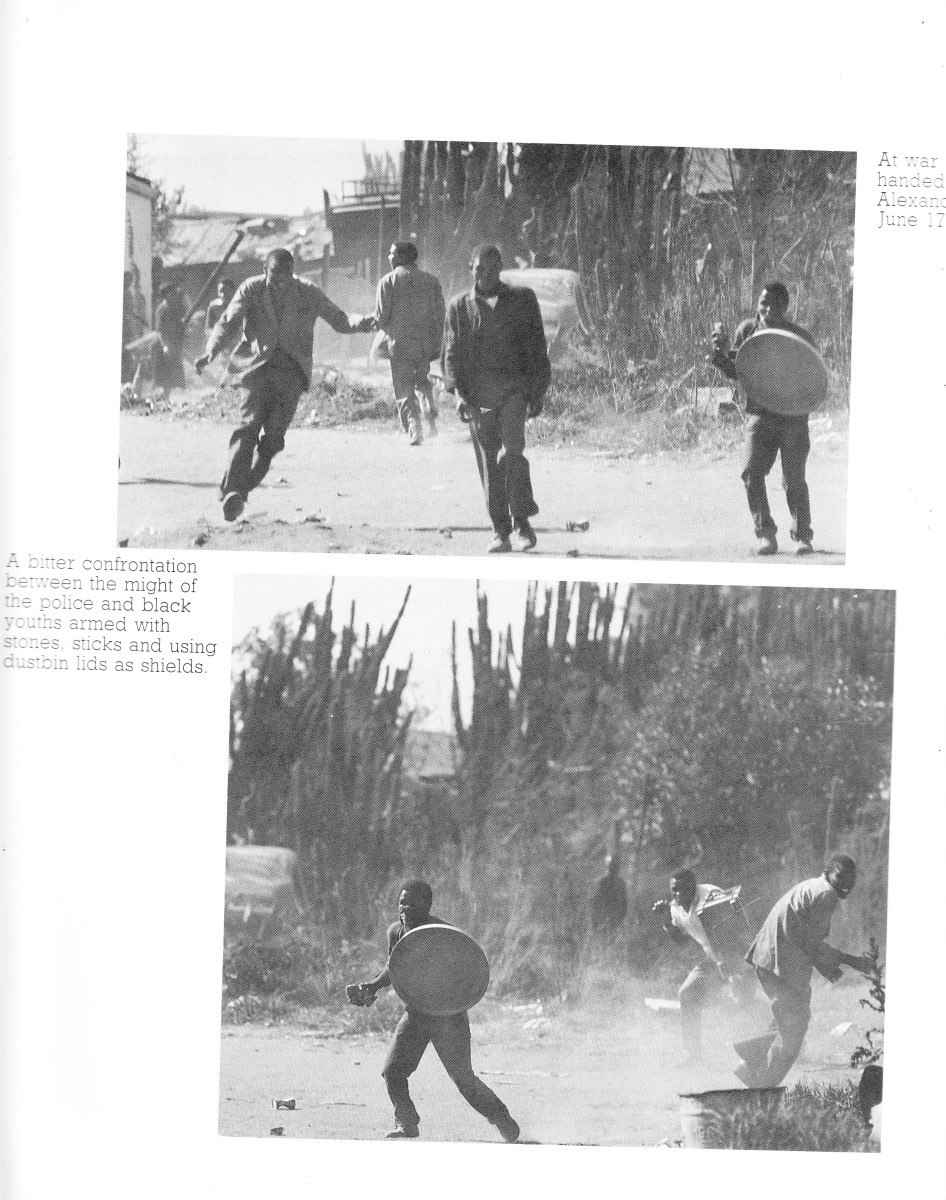 Students and locals engage in a nearly bare-handed, stones, sticks and using  lids as shield in a battle against the soldiers who were using rifles and llive ammo