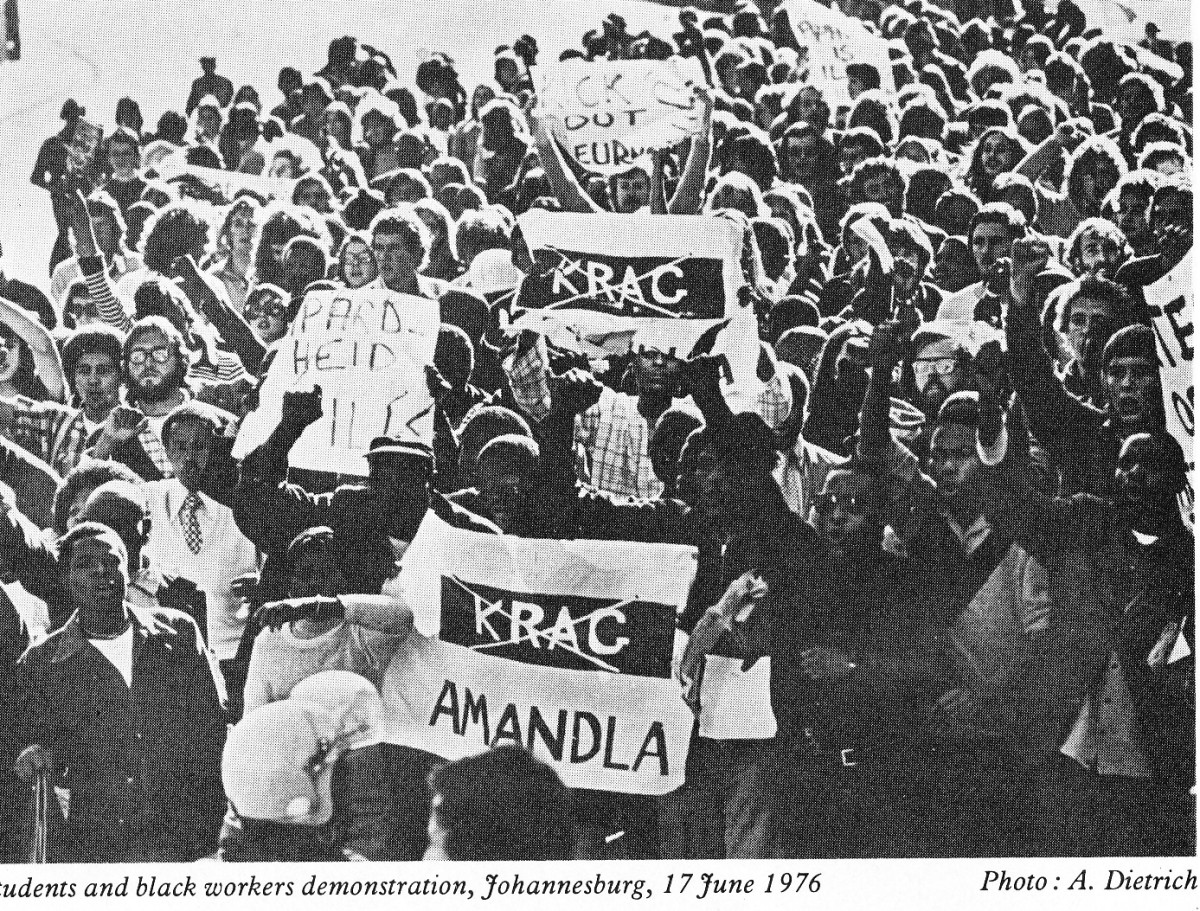 "Students and Black workers march on Jun 17th 1976 carrying placards and denouncing police might('Krag') written in Africans and crossed with an ""X:."