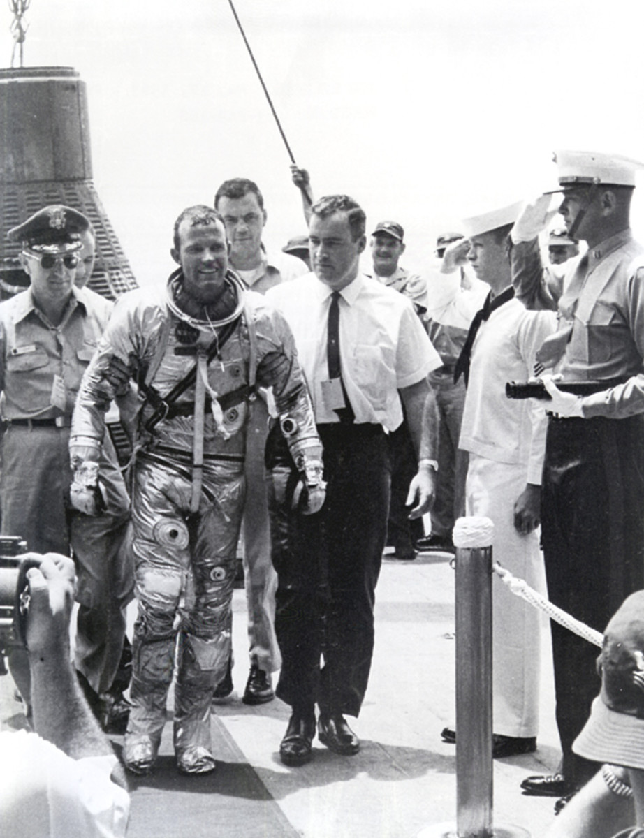 Gordon Cooper aboard the U.S.S. Kearsarge, following splashdown and recovery. Photo courtesy of NASA.
