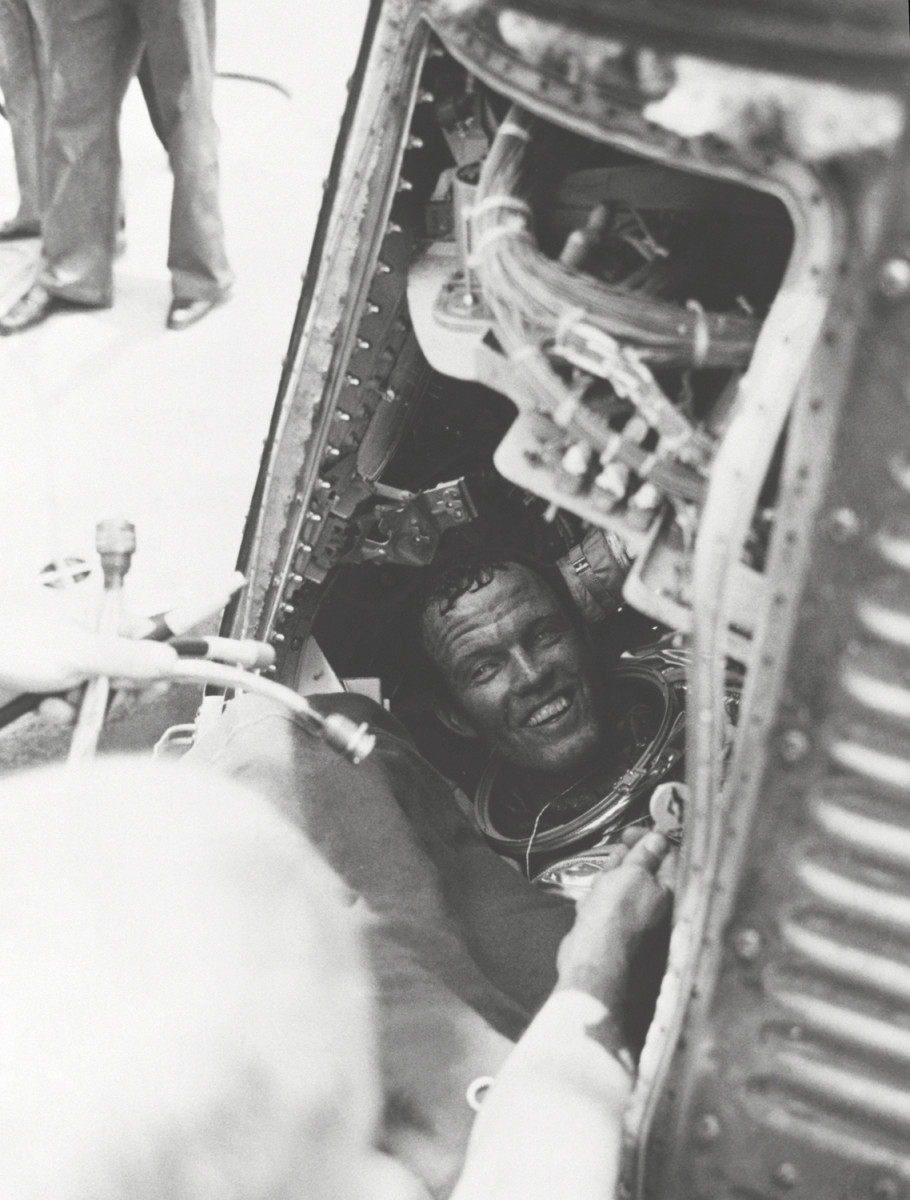 Aboard the U.S.S. Kearsarge, Gordon Cooper is about to exit Faith 7. Photo courtesy of NASA.
