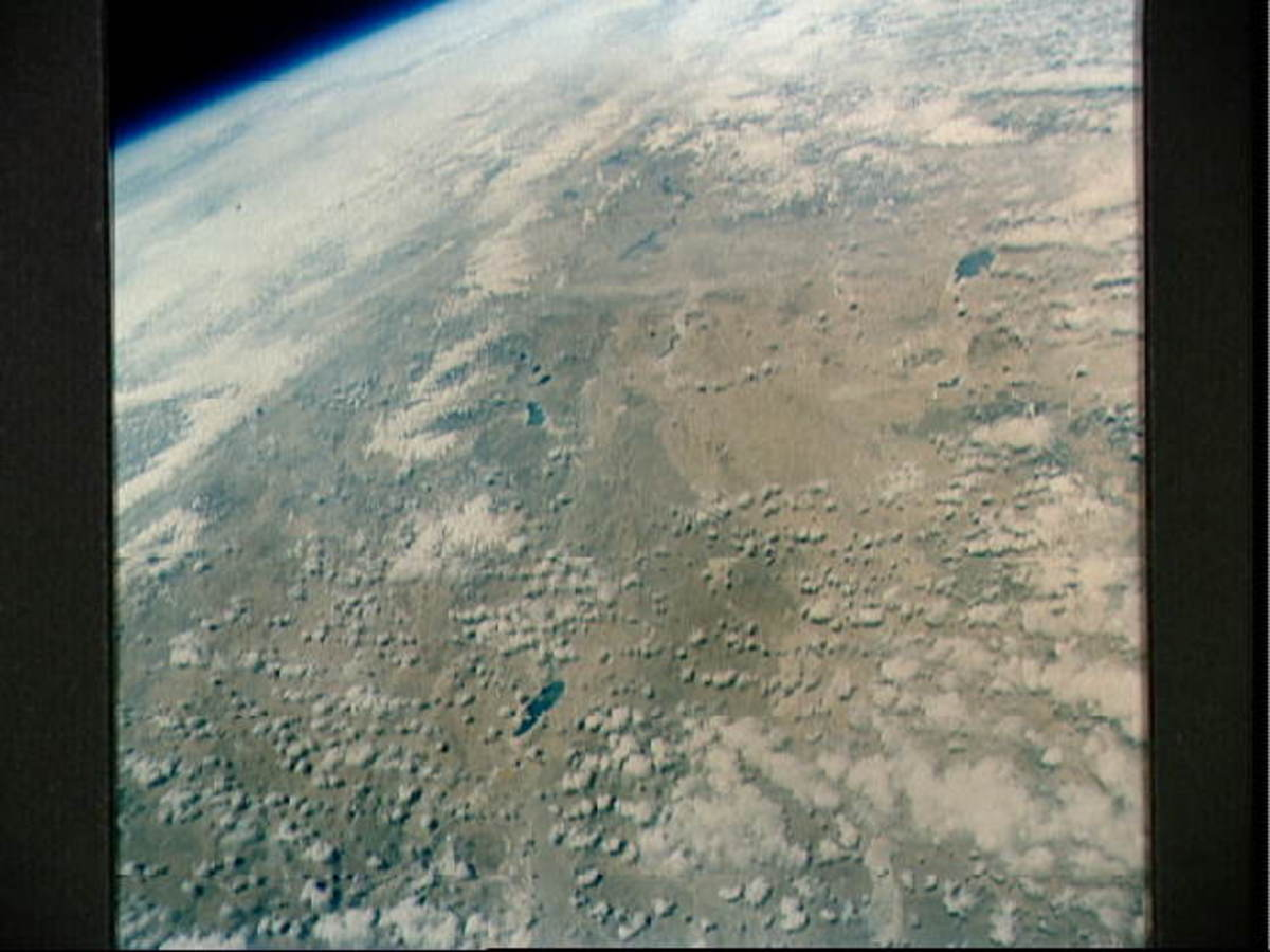 Photo of earth taken from orbit by Gordon Cooper aboard Faith 7. Photo courtesy of NASA.