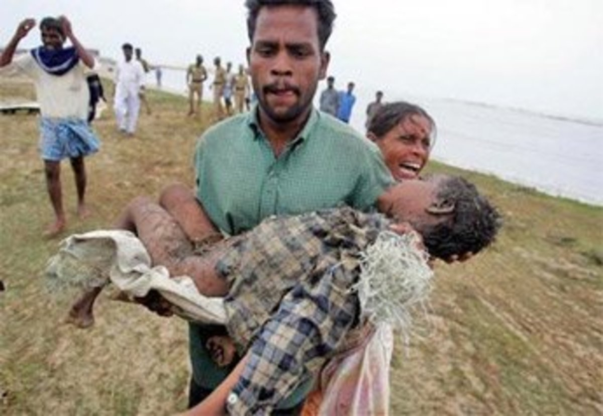 Desperate: A child hit by the tsunami in India is carried away