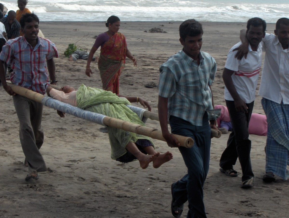 Sretcher: A woman who was caught in the wave is carried to safety