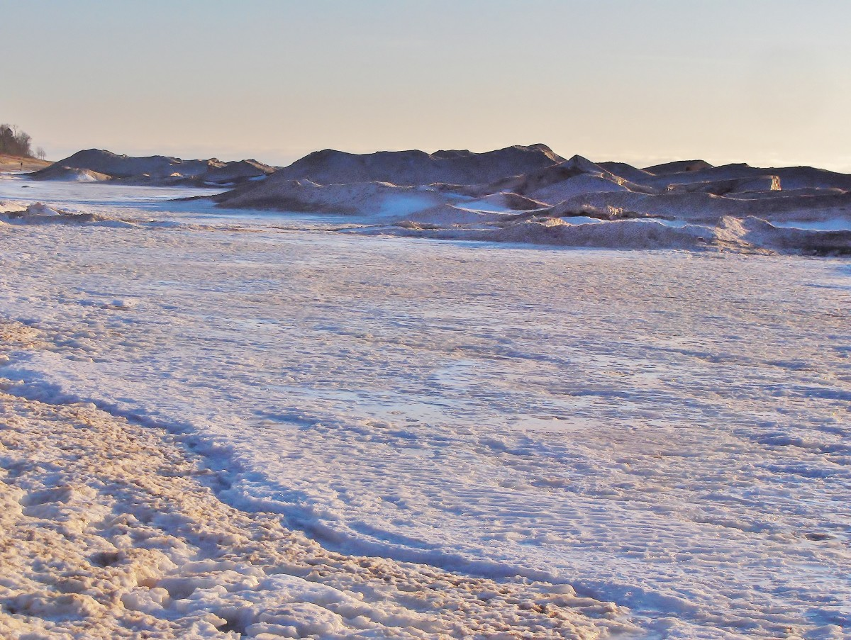 Safe to walk on this side of the 25 ft ice piles of Lake Michigan's winter ice shelf
