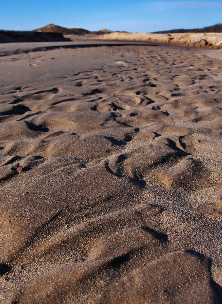 Sand ripples suspended by ice on the shoreline of Lake Michigan at Pier Cove Beach!
