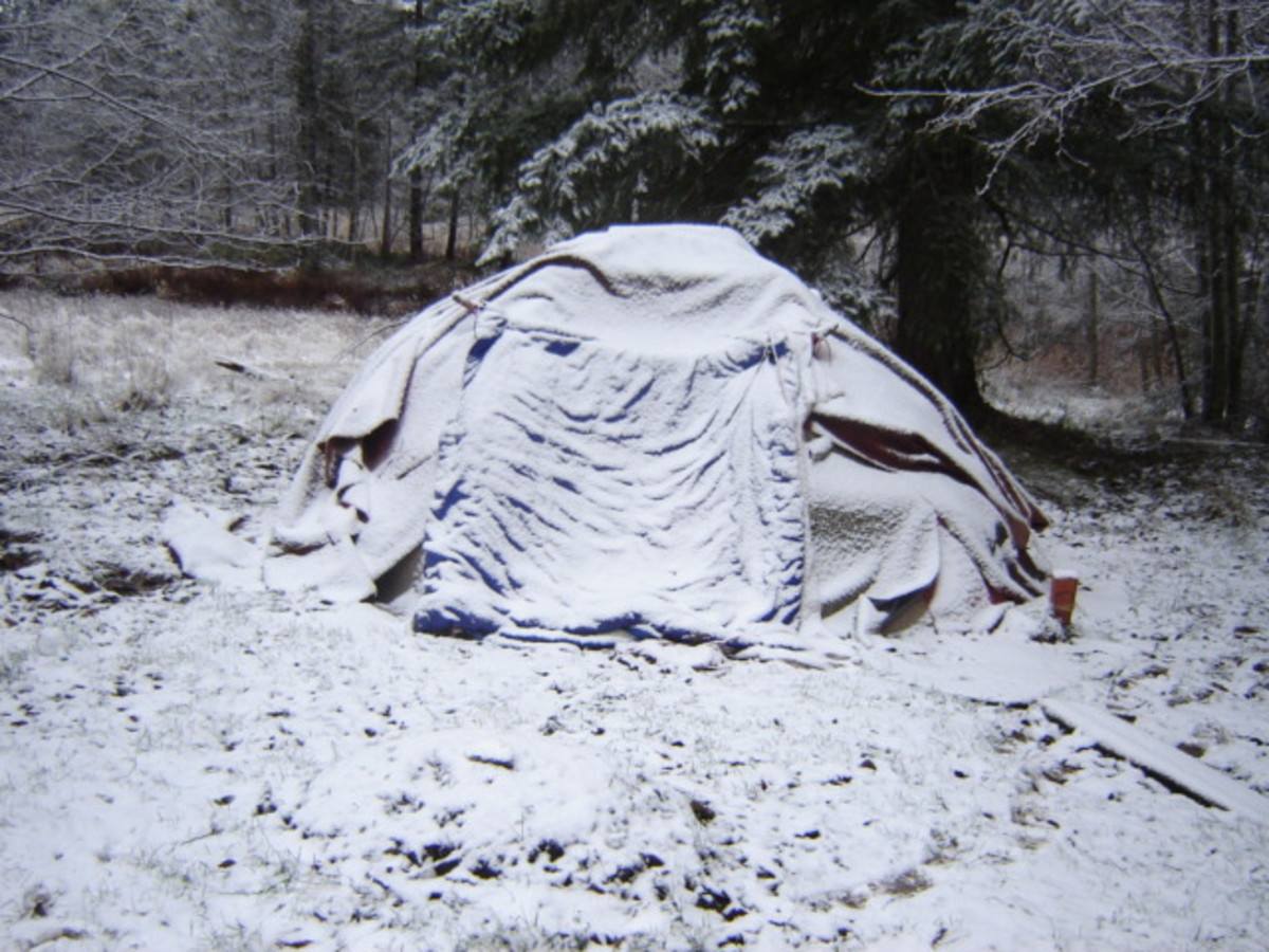 our sweat lodge with a light snow cover
