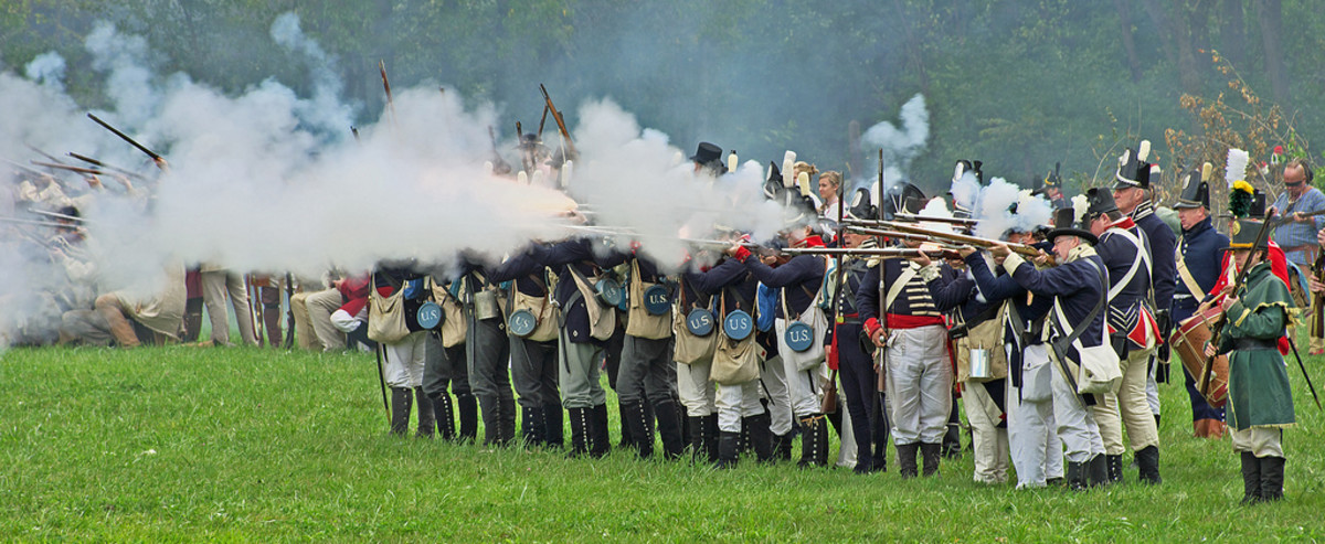 Volley of flintlock musketry from American regular infantry and militia.