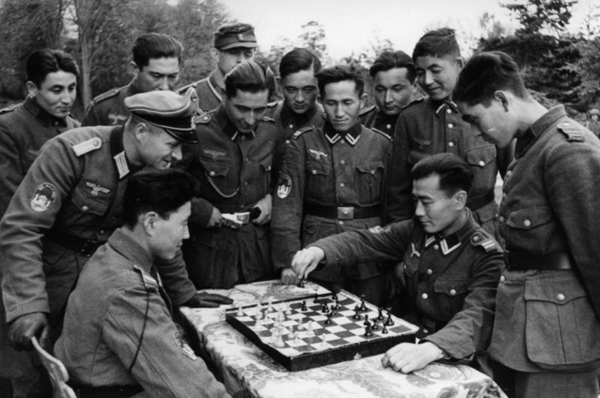 Some Chinese troops training in Germany in the 1930s stop to play a game of chess.