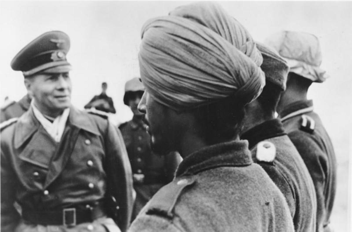 Famed German General Erwin Rommel inspecting Indian troops under his command. Note the traditional Pagri turban headdress, worn by the soldiers.