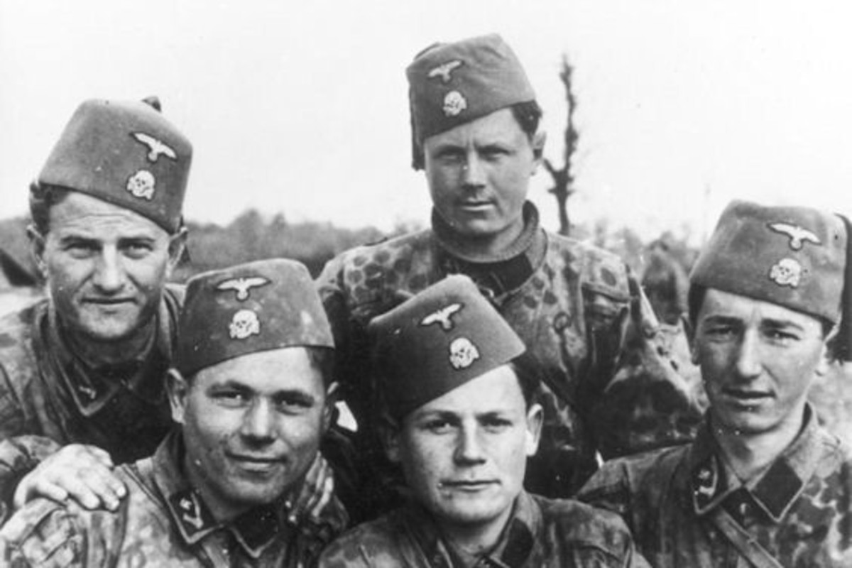 Bosnian members of the 13th SS Division. Note the traditional Fezzes (with German Eagle and Skull). Note also the middle-eastern scimitar swords their collar patches.