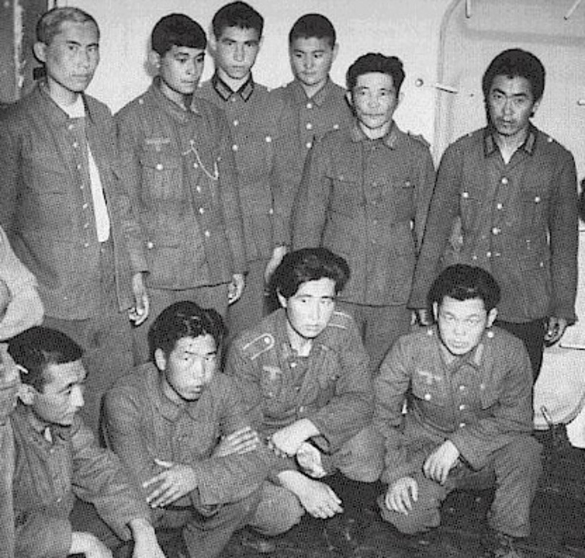 Korean soldiers dressed in German army uniforms. They were pressed into service by the Japanese, then the Soviets, then Germany, before being captured by Americans in France.