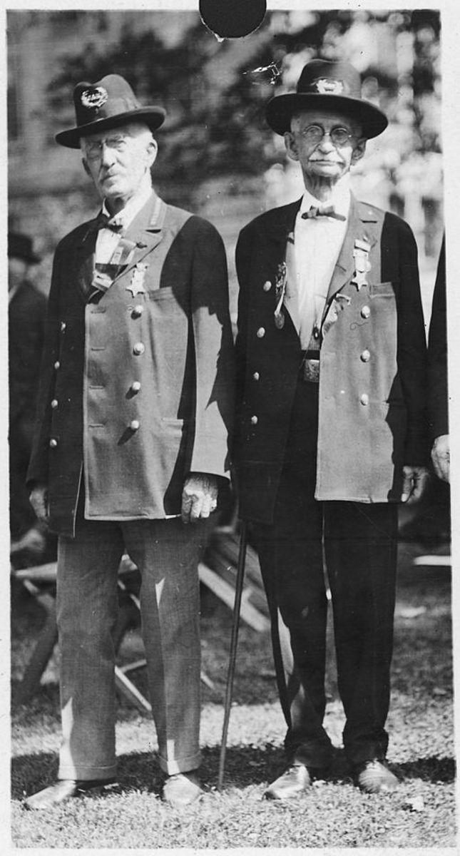 GAR uniform coats and hats shown