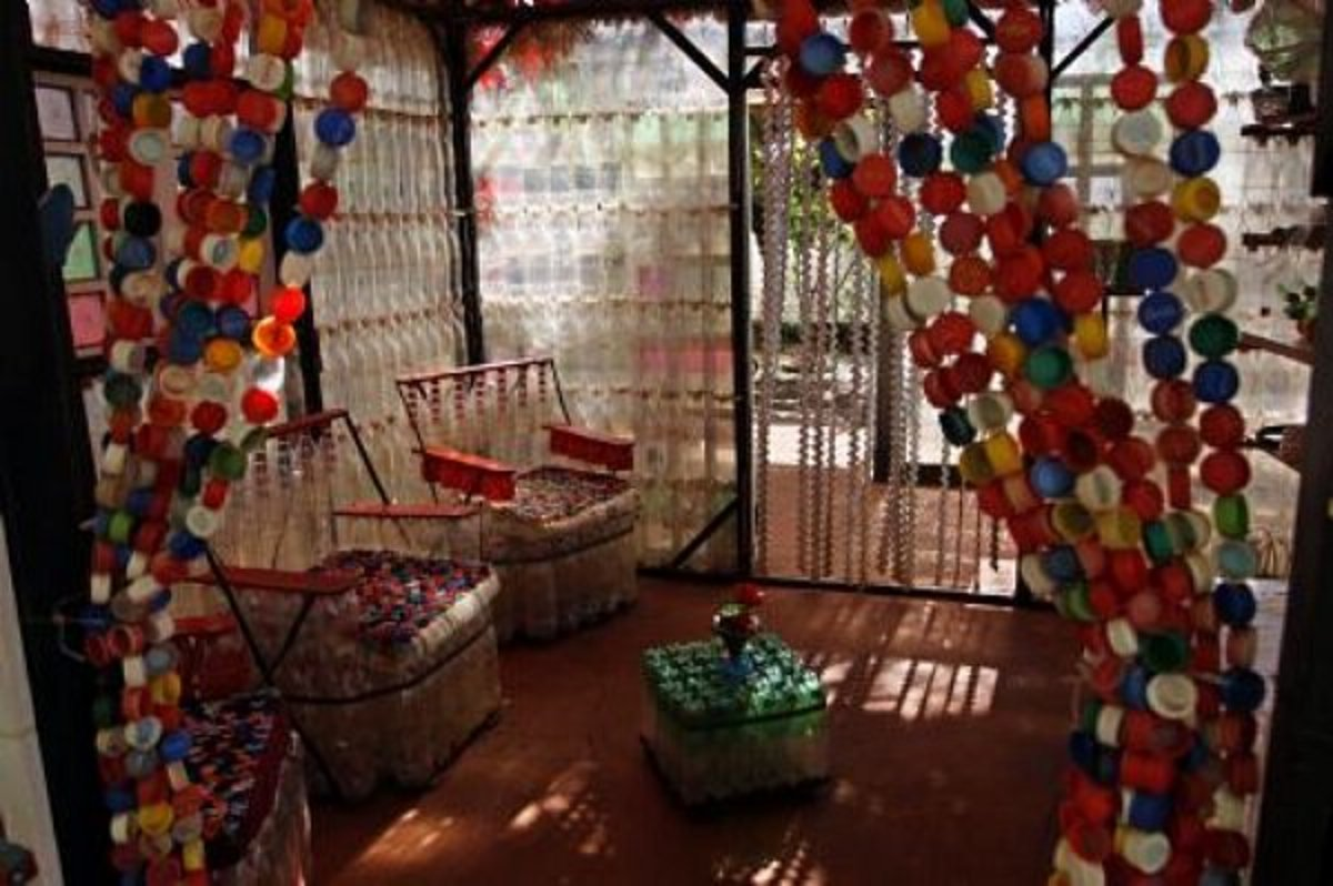 door curtain made from plastic bottle tops in a plastic bottle house