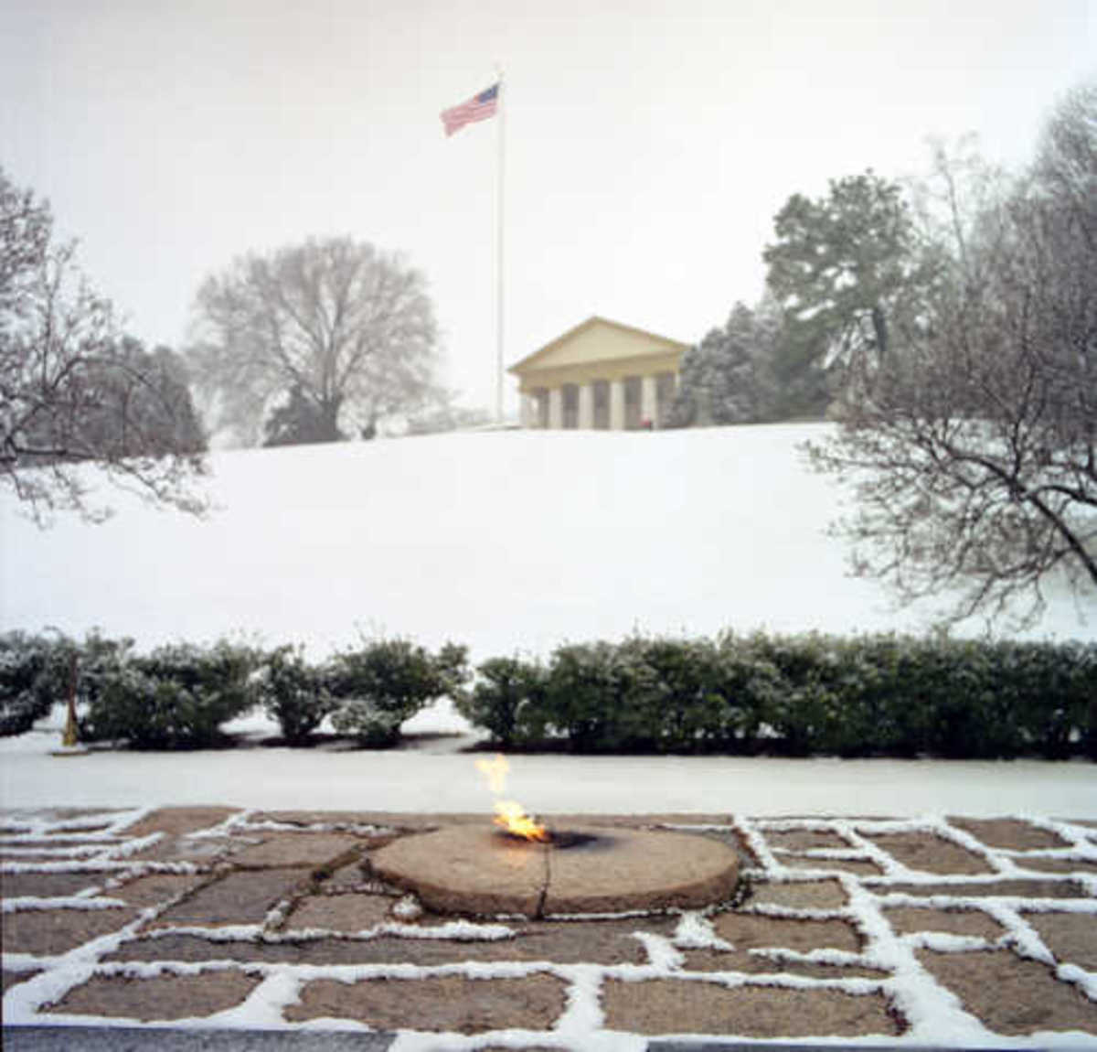 President Kennedy Gravesite and Eternal Flame with Robert E. Lee Mansion in Background