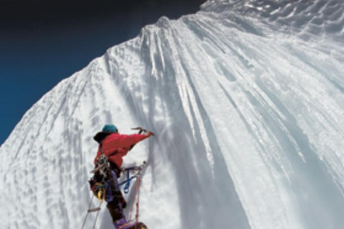 Scaling the side of an ice wall on Mt. Everest