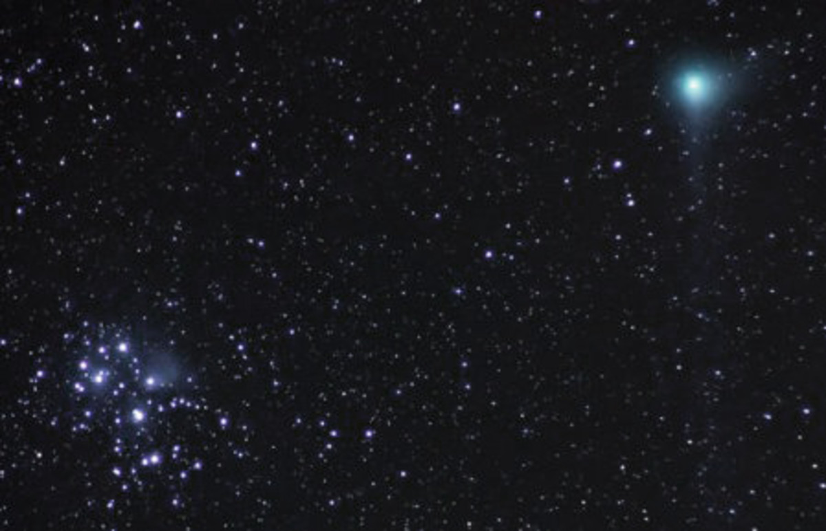 In this picture are two objects which can appear as fuzzy clouds in the night sky. A comet can be seen top right visually close to the loose star cluster known as The Pleiades.