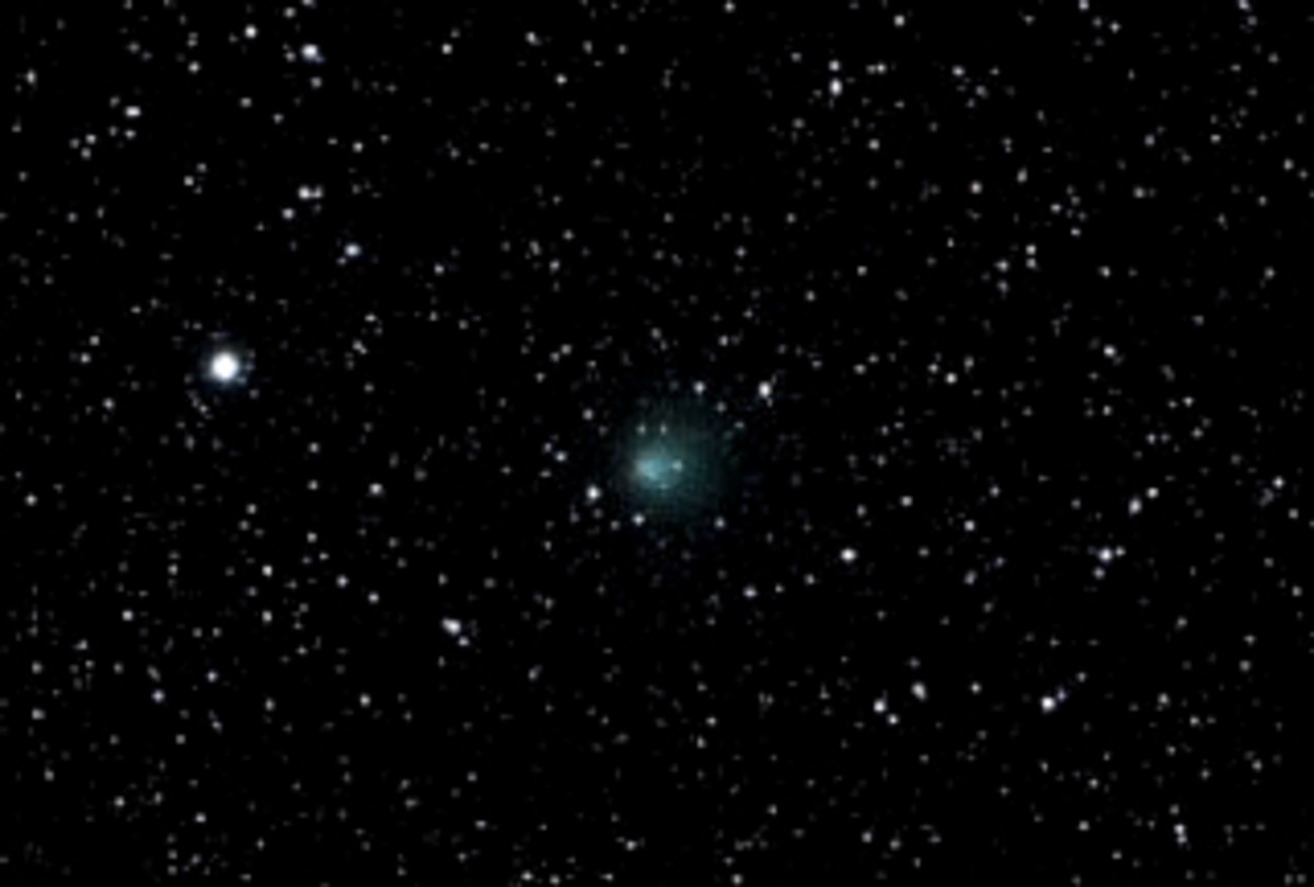 Encke's Comet. Occasionally a comet will become visible to the naked eye. Usually it will appear as a light smudge such as the comet in the centre of this image.