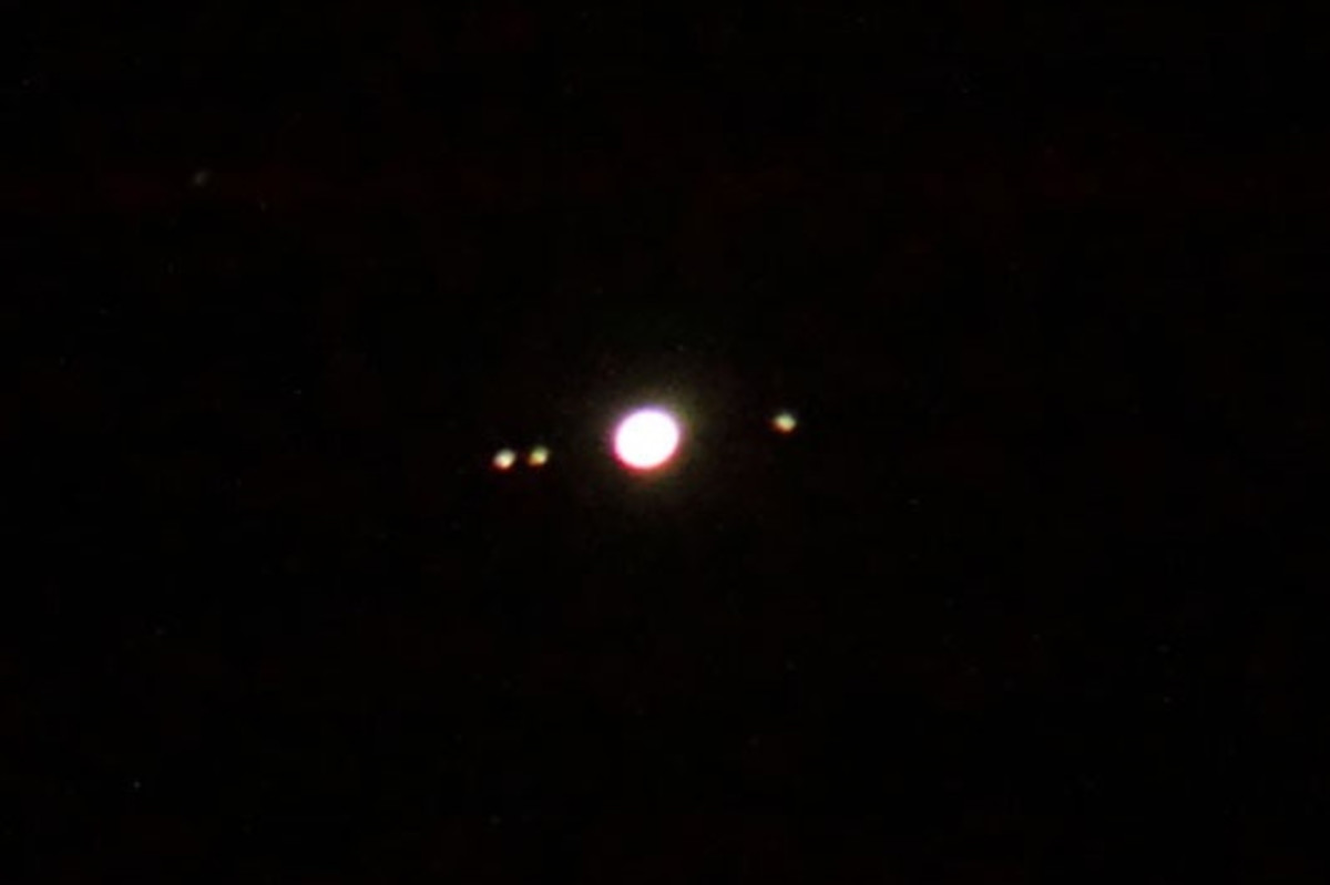 Jupiter and three of its moons. The image is not clear, but deliberately so, as it shows what you are likely to see of Jupiter's moons if you use simple binoculars. (In my binoculars, the planet and moons appear a bit sharper than this, but fainter