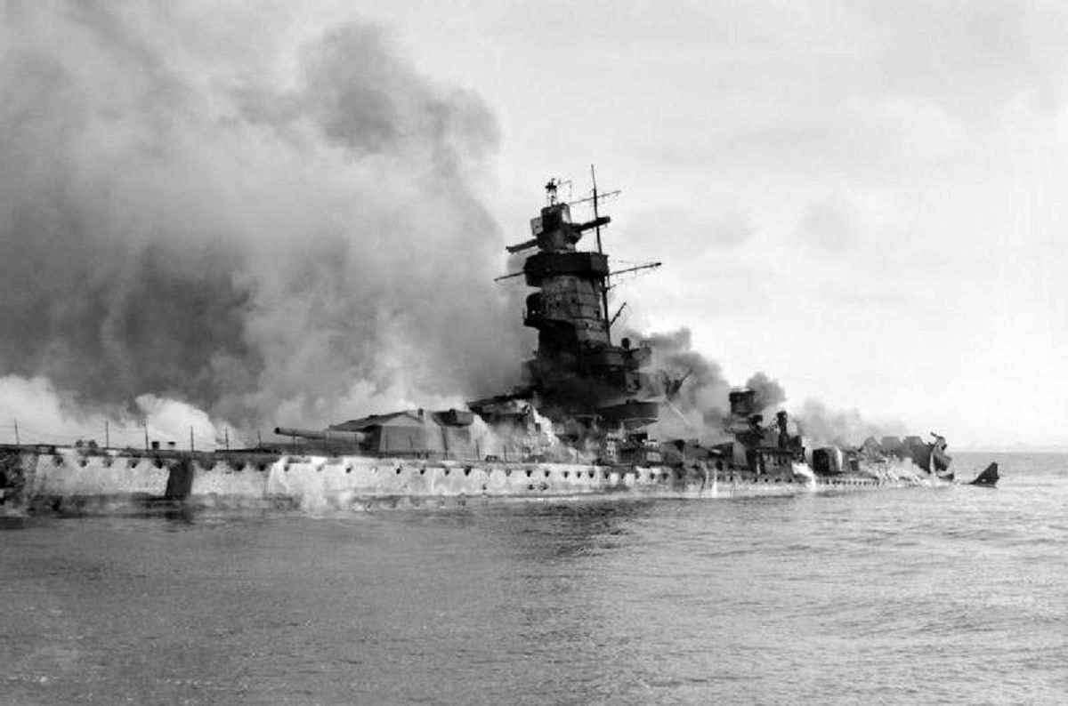 Admiral Graf Spee scuttled and in flames in the River Plate Estuary off Montevideo, Uruguay after being tricked into thinking a large British force awaited her in international waters. December 17, 1939.