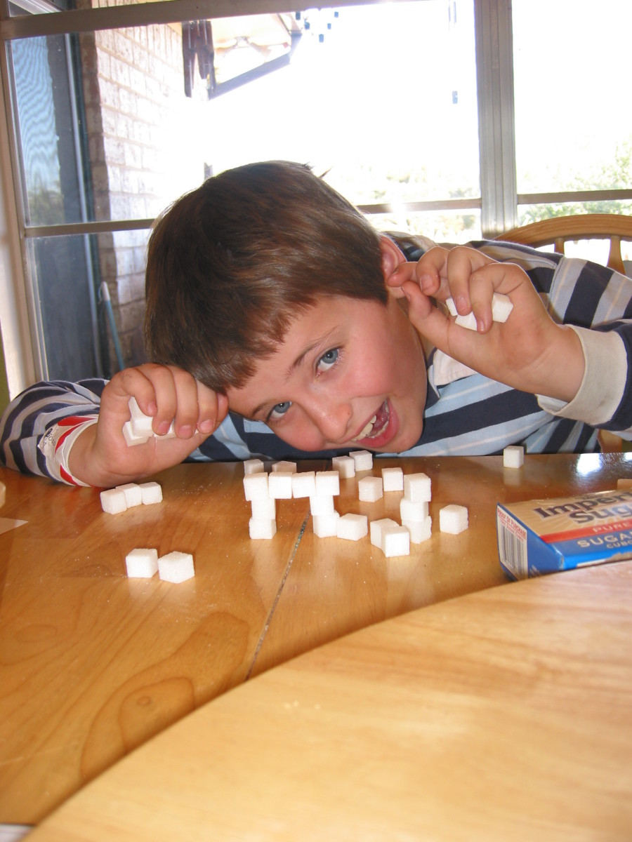 2. Put a sugar cube in between and push the stacks together to hold it.