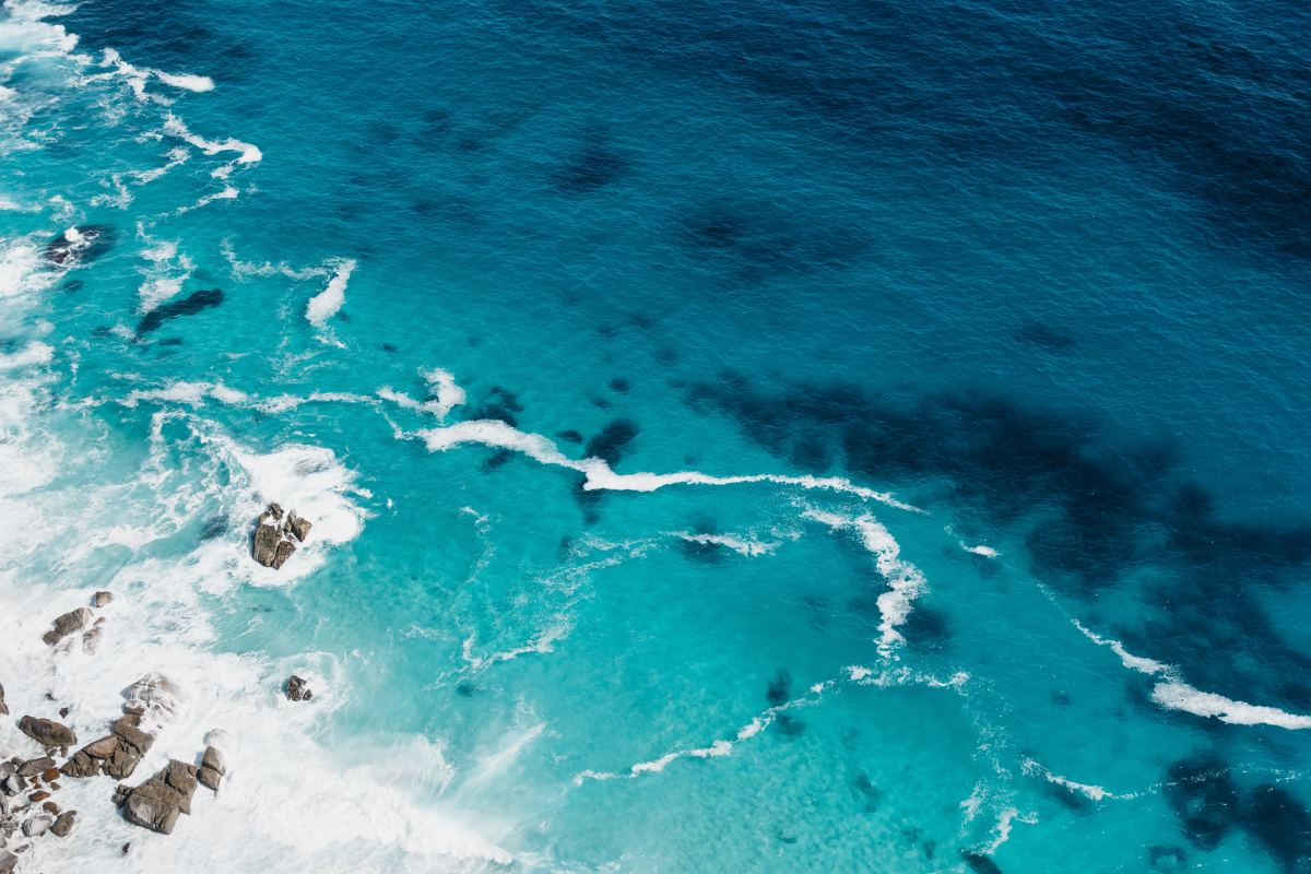 The ocean is blue for the same reason the sky is blue: the shortness of blue light waves.