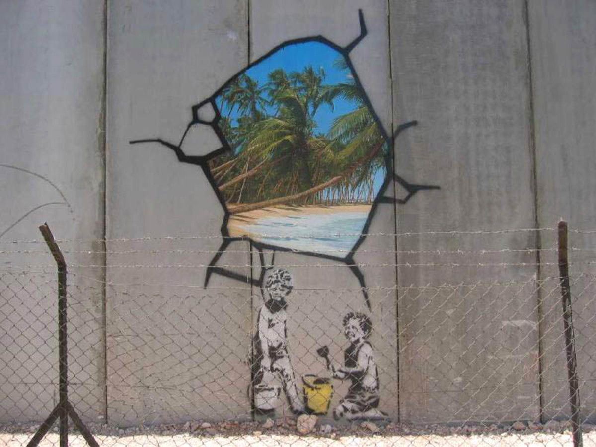 Image of hole in the wall, Israeli defensive barrier near Bethlehem Near 2005.  Banksy's themes generally express ideas associated with left wing and anarchist beliefs, satirizing capitalism and established orders.