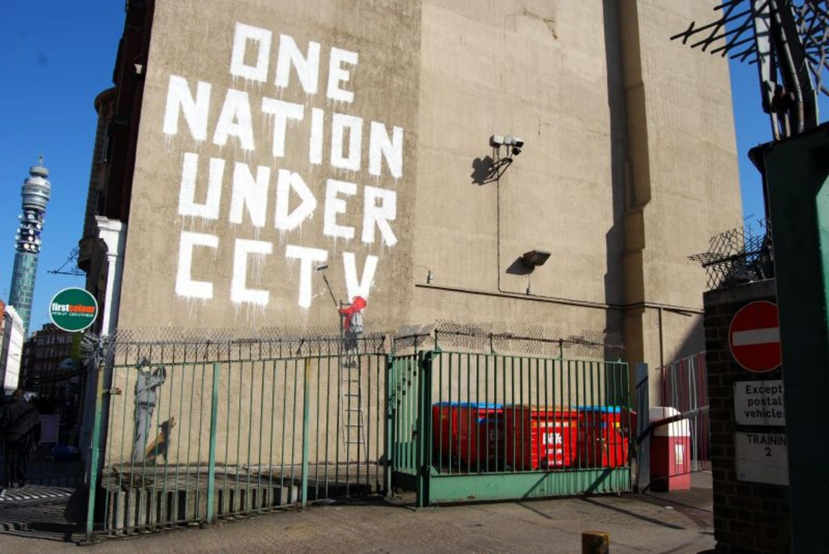 One nation under CCTV by Banksy.  The mural appeared in 2008, but was painted over in 2009.