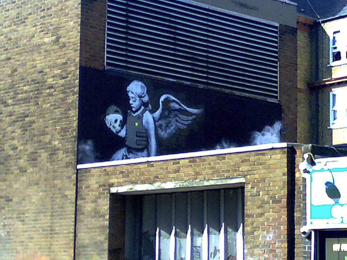 Ozone's Angel by Banksy.  Although still considered vandalism by some, Banksy's art can now often fetch big prices when auctioned.