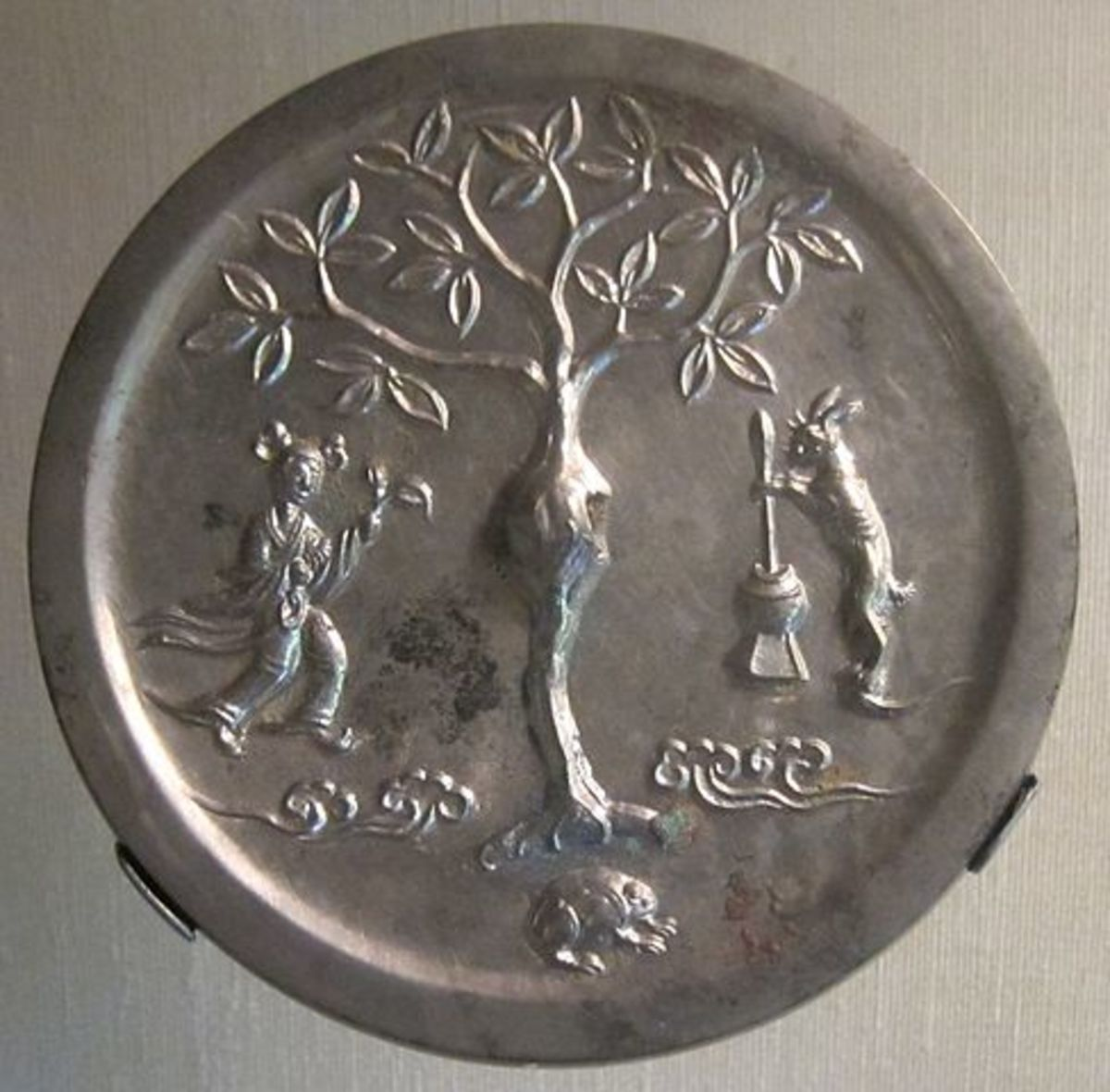 A Tang dynasty (618-906 AD) era mirror depicting the moon goddess Chang'e with the moon rabbit.
