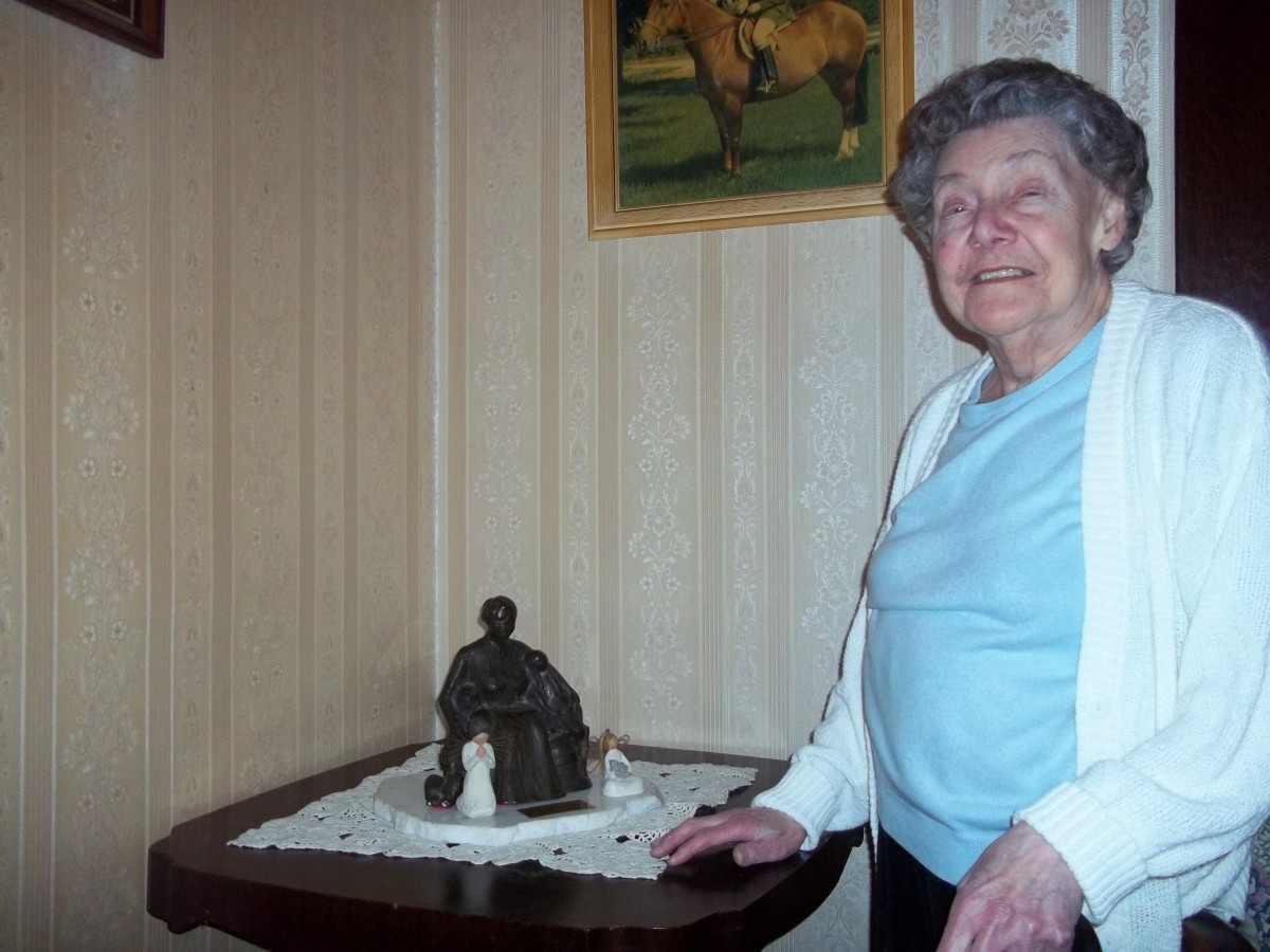 Muriel proudly displays a family heirloom...Rosa and her three children...created by Joyce McDonald...born a Casorso...and renowned sculptor.