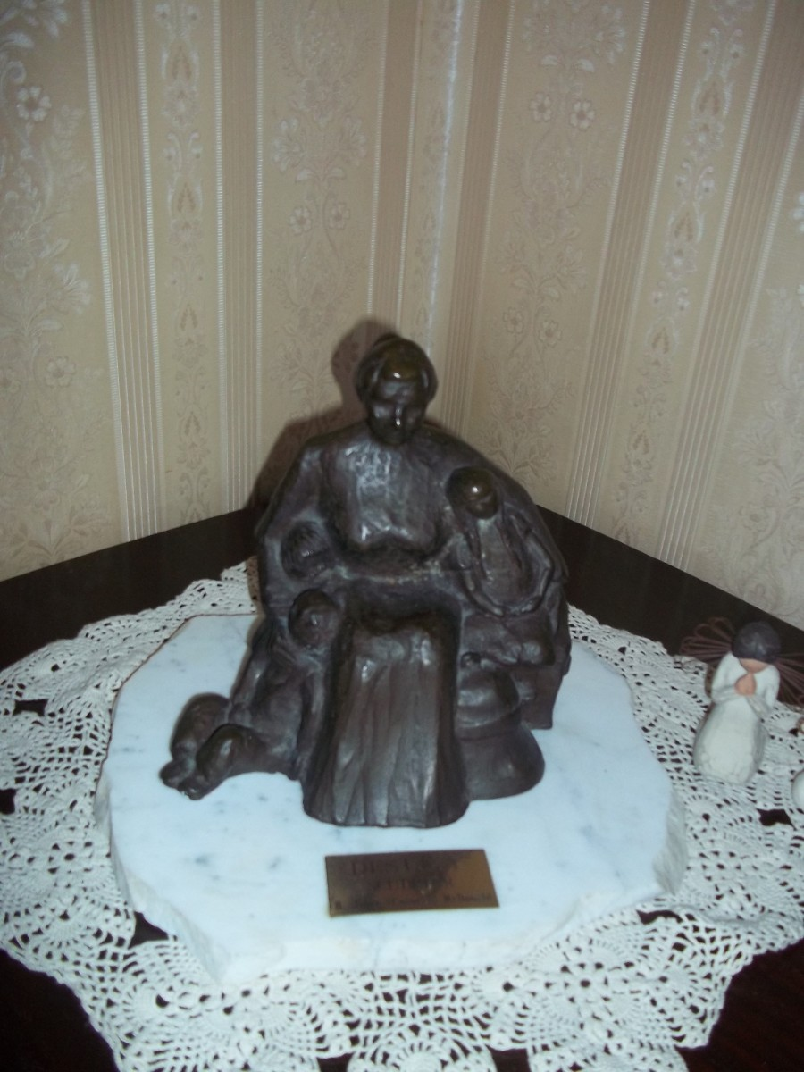 A bronze replica of the work of Joyce (nee Casorso) McDonald given to Muriel as a gift.  Notice the three children in Rosa's arms...the arduous trip of coming to the New World is remembered.
