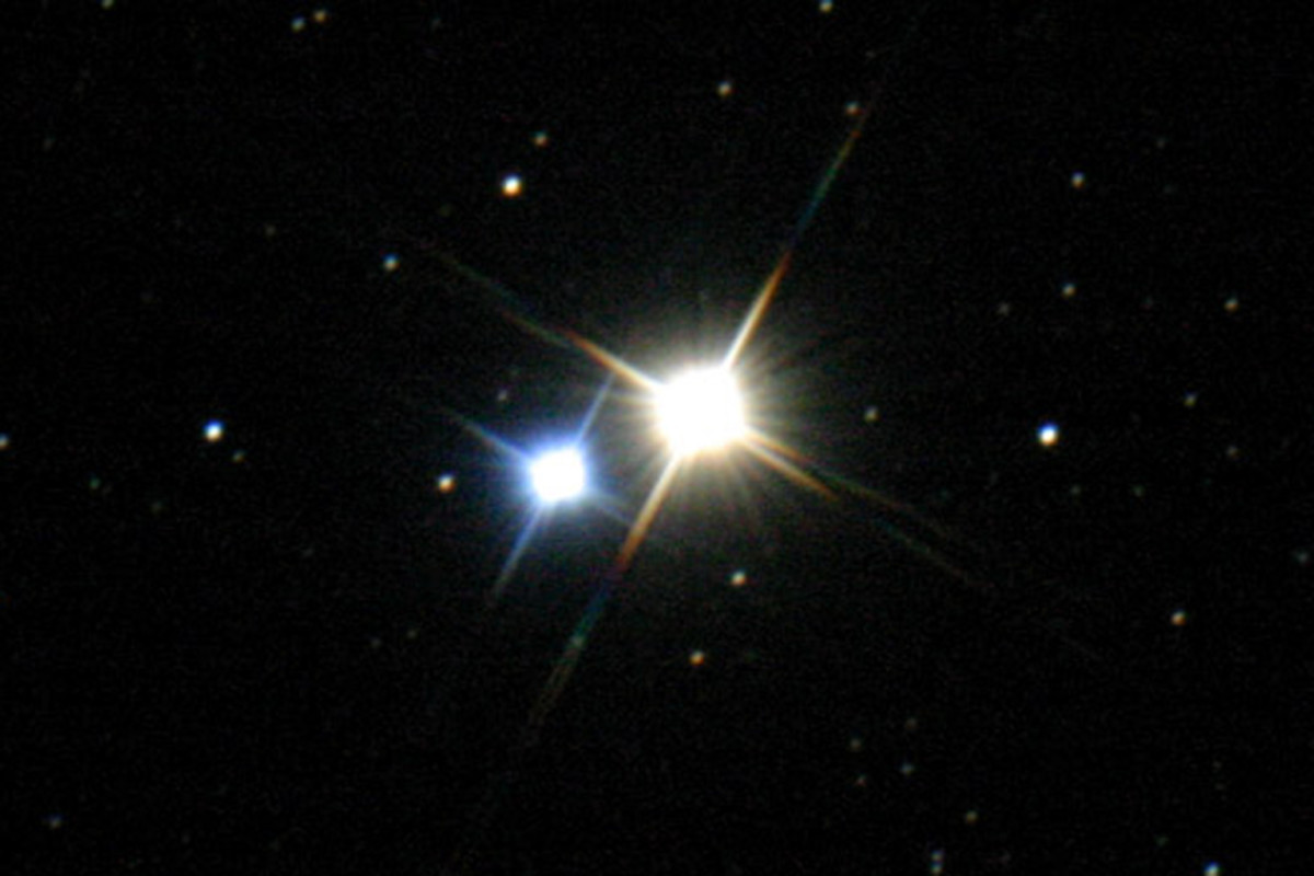 Albireo - a true binary star in which an orange giant star and a hot blue star revolve around each other at great distance