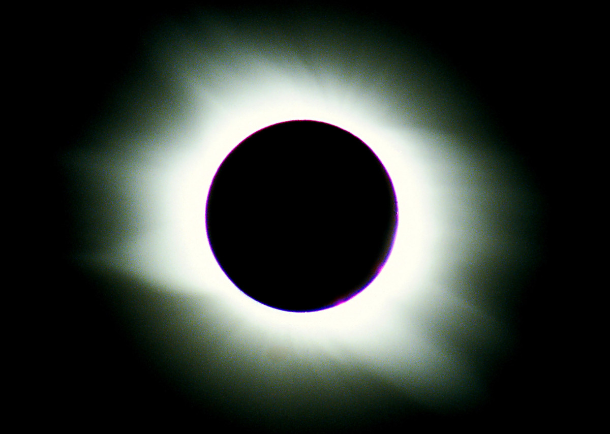 My own photo of a total eclipse of the Sun, taken in the Libyan desert in 2006. The flaring white light visible beyond the unlit Moon is the Sun's corona - only visible to us during a total eclipse