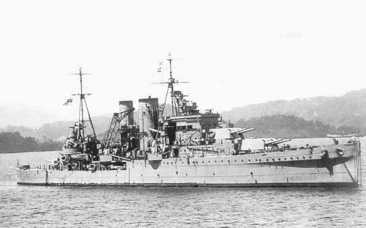 "WW2: Heavy cruiser HMS Exeter was put out of commission by the Graf Spee. All three of her 8"" turrets had been knocked out along with other significant damage. 61 officers and ratings were KIA. Image shows HMS Exeter off the coast of Sumatra (Netherl"