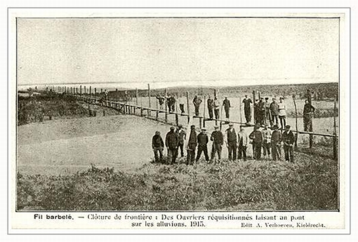 WW1: Constructing the fence in a flooded area.