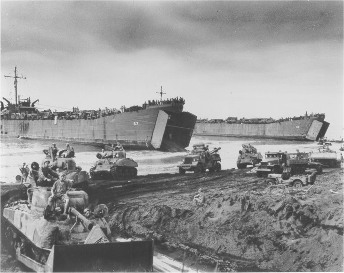 "WW2: Sherman tanks disembarking from an LST. LST stood for ""Landing Ship, Tank""; their crews referred to them as ""Long Slow Targets""."