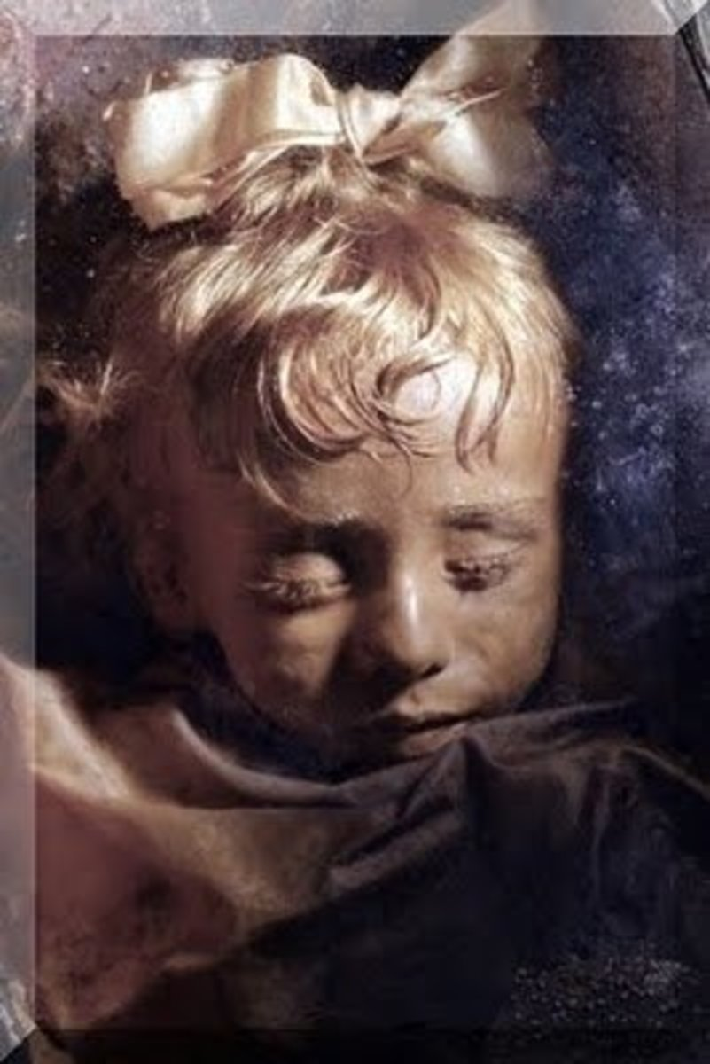 The Child Mummy (100 years young) is Rosalia Lombardo. When she died in Sicily in 1920 of pneumonia, her father was so upset he had her preserved forever.