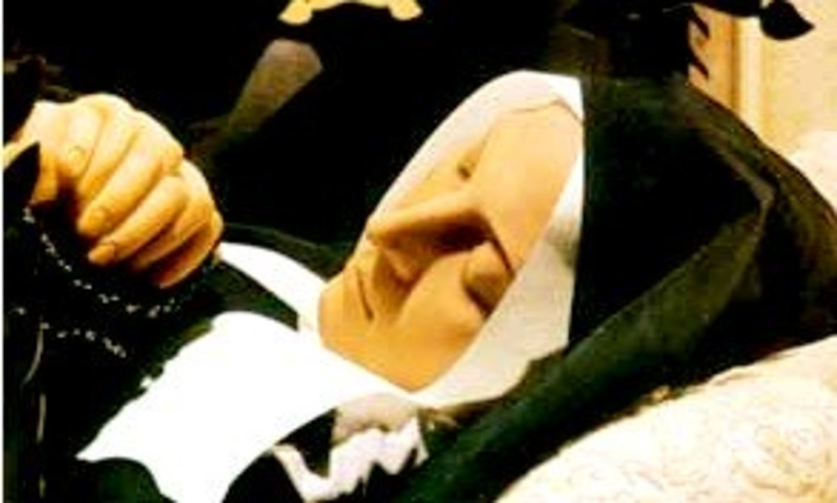 St. Bernadette in death. Her face and hands have been covered in wax as customary with french incorrupt saints.