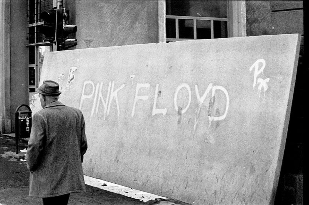 "Sarajevo, winter of 1992-1993. Feature film director and screenwriter Mehmed Fehimovic passes a concrete sniper screen whose Pink Floyd graffito reminds him of their ""All in all, you're just another brick in the wall."""