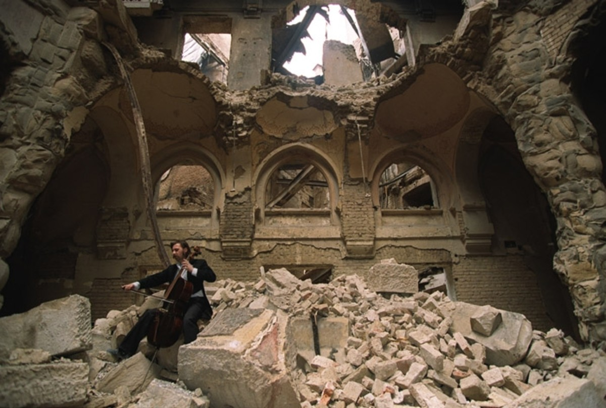 Cello player Vedran Smailovic plays in the partially destroyed National Library.
