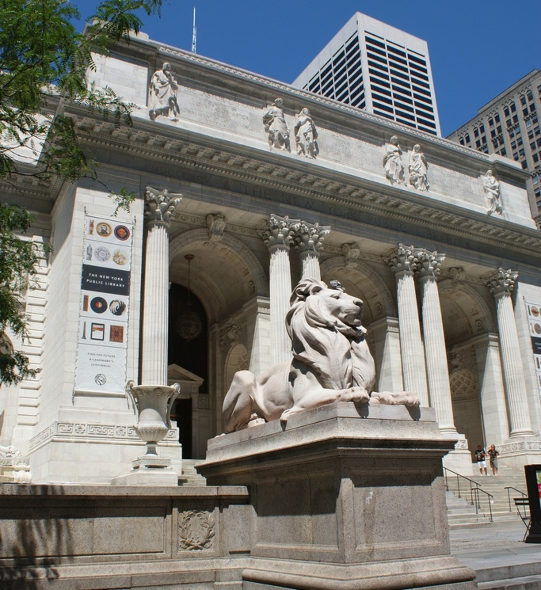 The New York Public Library, built in Beaux-Arts style between 1902 and 1911, includes ancient Greek influence in such elements as stylized Corinthian columns, high-relief sculpture in the frieze, and the extensive use of marble.